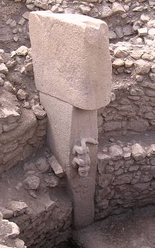 A photograph of a animal adorned pedestal at Gobekli Tepe.