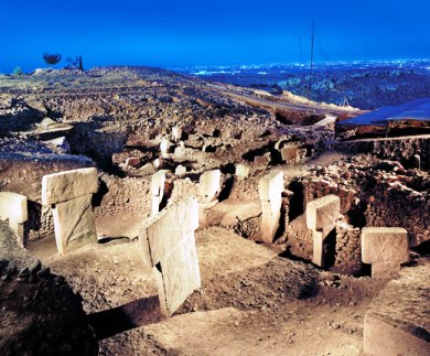 A photograph showing the hilltop ruins of Gobekli Tepe.